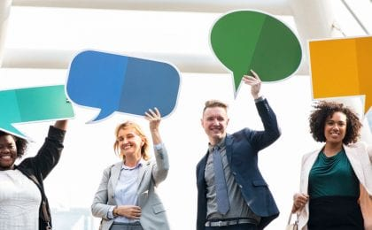 four people holding speech bubbles above their heads