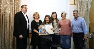 Shoshana, (3rd from the left), receiving the Immigrant of Excellence award, together with her school counselor and ministers of education.