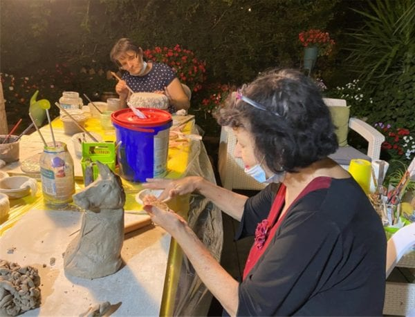 Seniors in Har Gilo, one of the Gush Etzion communities, participate in a ceramics workshop for occupational therapy and social-distanced socializing.